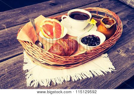 Vintage Photo Of Coffee And Croissant. Breakfast Table