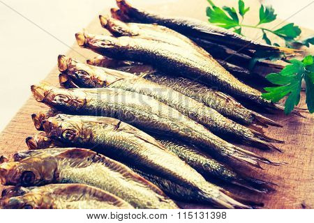 Vintage Photo Of Smoked Sprats On Cutting Board