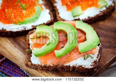 Appetizer With Red Caviar, Avocado, Salmon And Creamcheese