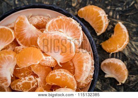 Ripe Juicy Mandarin Fruits on Black