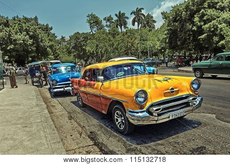 CUBA, HAVANA-JULY 10, 2015: Classic yellow american car on a street in Havana