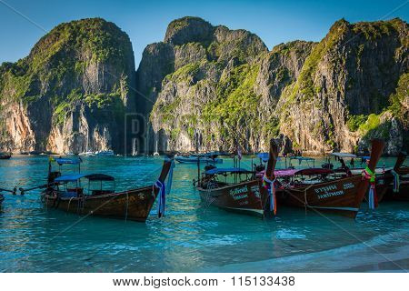 Maya Bay, Thailand,december 9,2013:traditional Thai Longtail Boats Docked In The Popular Maya Bay.