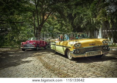 CUBA, HAVANA-JUNE 27, 2015: Cubans go to the classic american old car on the streets of Havana