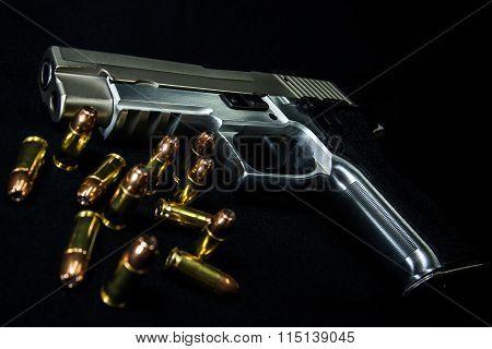 Gun And Ammunition On Black Background