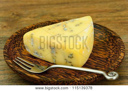 Blue Cheese Roquefort on Wooden Plate.
