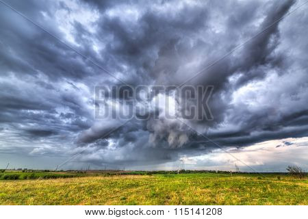 Stormy clouds over the meadow in Poland
