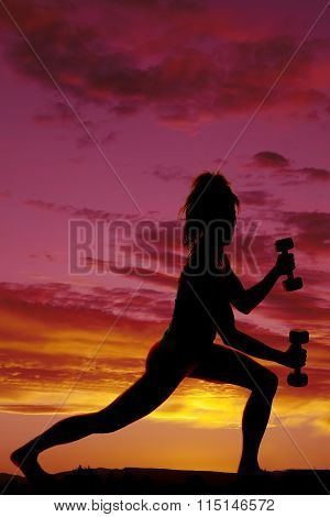 Silhouette Of Woman Doing A Lunge With Weights In The Sunset