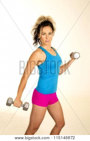 Woman Blue Tank And Pink Shorts Fitness Weights Side Look