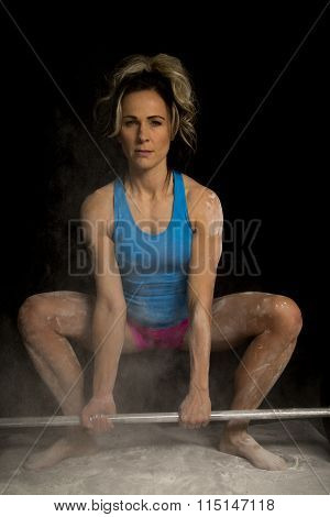 Woman In Pink And Blue Fitness Attire Powder Looking