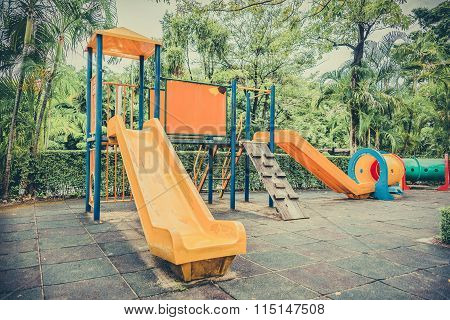 Old Children Kid Playground With Sliders And Tunnel Leftover In The Park In Childhood Vintage Color