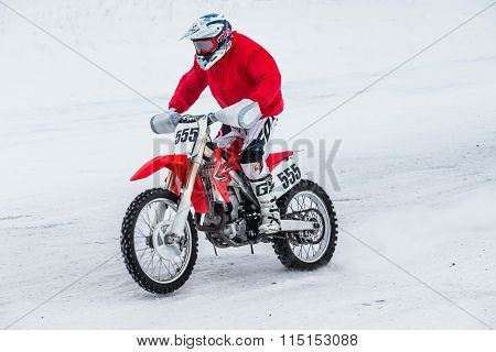 motorcycle racer in a bright red winter jacket