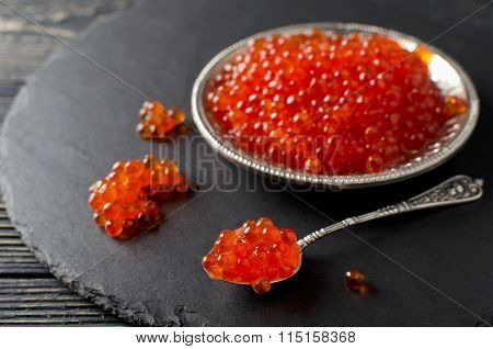 Red Salmon Caviar On Black Background