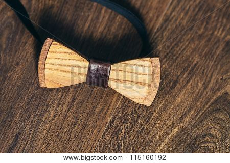Grooms Wooden Bow-tie On Wooden Background