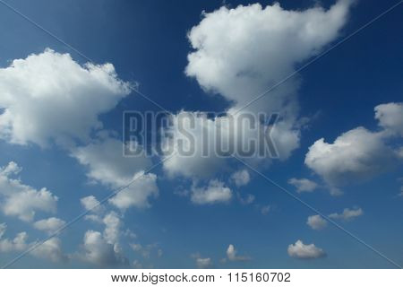 Blue sky with clouds at sunny day