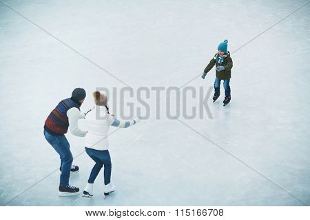 Family on skating rink