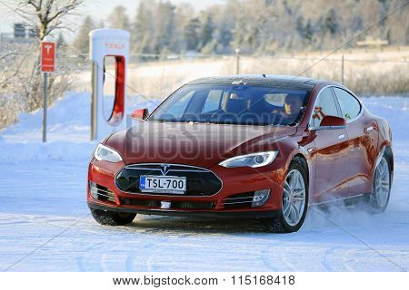 Red Tesla Model S Electric Car In Winter Snow