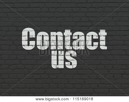 Advertising concept: Contact Us on wall background