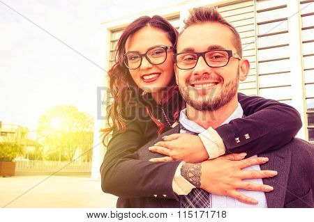Young Cheerful Couple With Woman Embracing Man With A Positive Attitude And Smiling Face