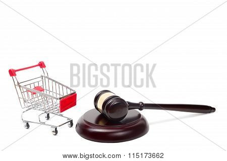 Judge gavel and shopping cart isolated on white background.