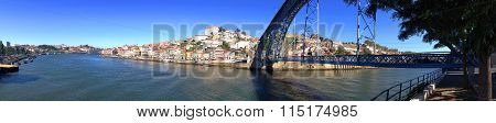 background cityscape panoramic view of the embankment of the river Douro and Dom Luis Iron Bridge