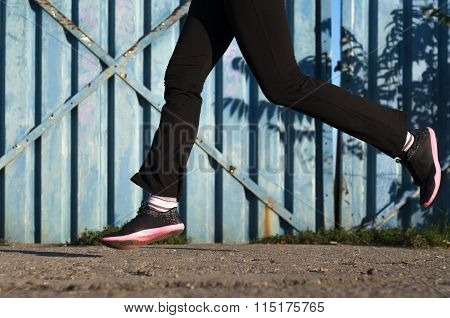 Low Section Of A Lady Running