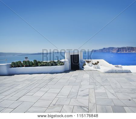 Terrace on Santorin island with a view on azure Mediterranean sea.