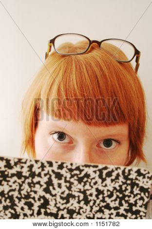 Woman Lookup Up From Notebook