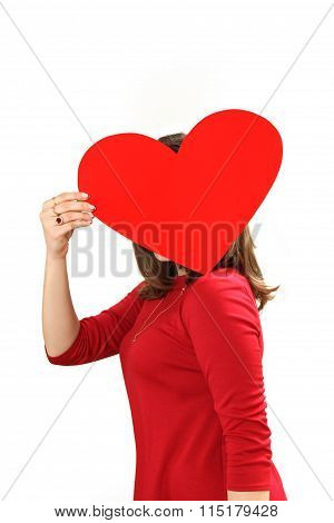 The Effective Young Woman In A Red Dress With Red Heart Valentine's Day Card In Hands
