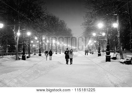 People Walking At Night In Snow