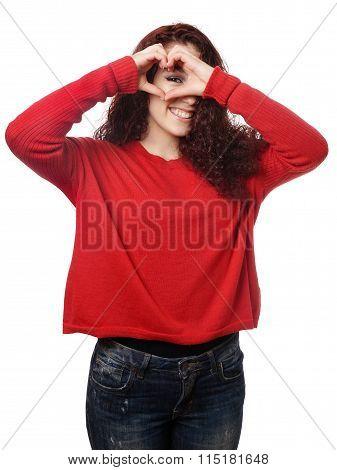 girl peeking through heart shape hand sign