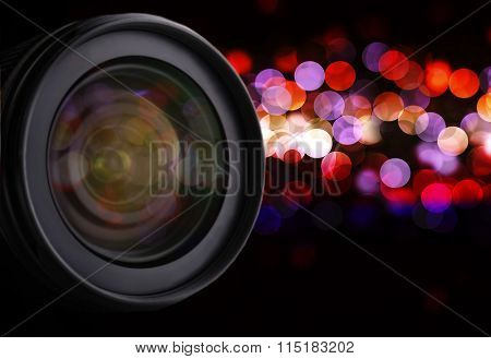 Lens of camera on abstract night background, close up