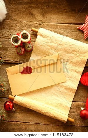 Christmas concept. Wish list with Christmas decorations on wooden background
