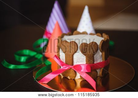 Dog Cake  Decorated With Bone Cookies And Birthday Hat