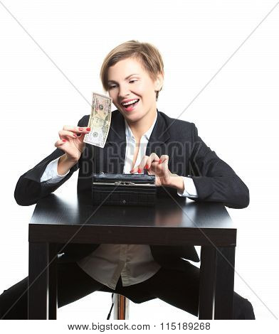 girl plans to budget. Dollar said. She is counting money at the table