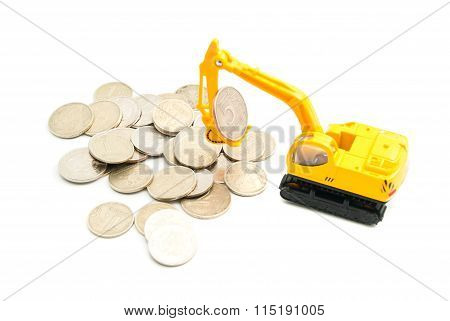 Coins And Yellow Backhoe
