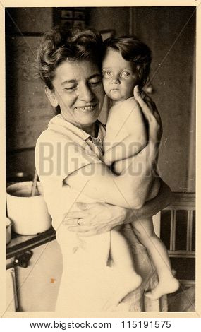 Vintage photo of mother and baby circa 1941.