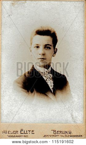 Vintage photo of young man. Portrait photo was taken in photo studio circa 1930.