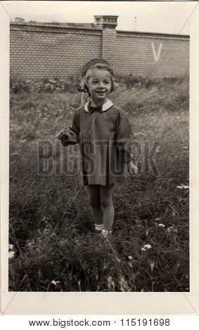 Vintage photo of a small girl circa 1943.