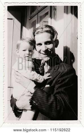 Vintage photo shows a small girl with her uncle circa 1941