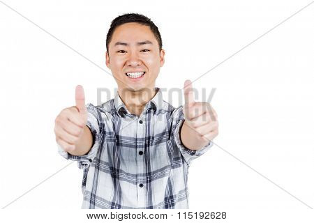 Happy man showing thumps up against white background