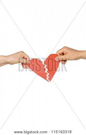 Couple holding broken heart on white background