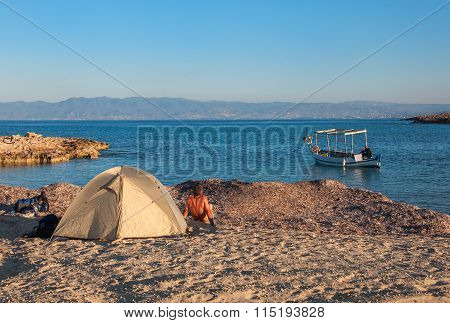 Tent And A Fishing Boat On The Sea