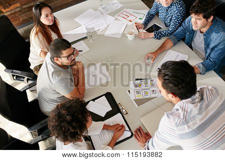 Team Of Creative Professionals Meeting In Conference Room