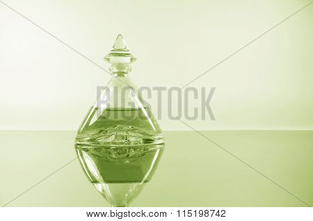 Pale Lime Perfume On Mirror Surface