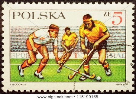 Field Hockey Match On Postage Stamp