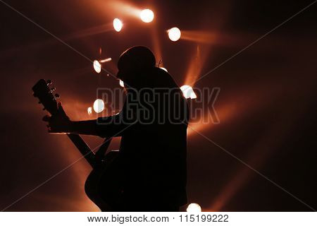 Guitarist plays on rock concert