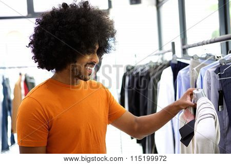 Guy Looking At Clothes In Store