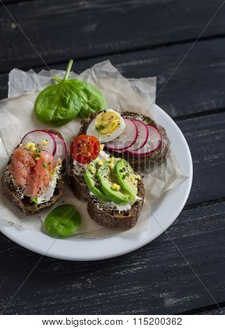 Assortment Of Sandwiches - Sandwiches With Cheese, Radish, Cucumber, Quail Egg, Avocado And Smoked S