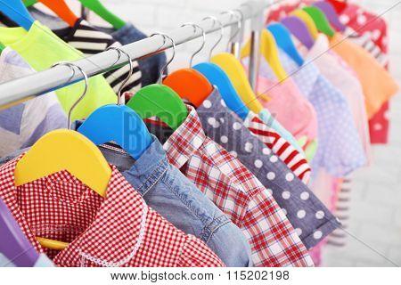 Children clothes on hangers closeup