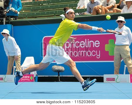 Marcos Bahdatis runs for a backhand